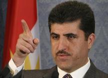 Primeiro-ministro do Curdistão, Nechirvan Barzani, gesticula durante coletiva de imprensa em Arbil, cerca de 350 km ao norte de Bagdá. O Iraque não poderá financiar o déficit orçamentário para 2014 caso a região do Curdistão, no norte do país, não pague os rendimentos provenientes da exportação de petróleo ao Tesouro nacional --ou então perca sua fatia em gastos do governo--, disse à Reuters o chefe da comissão para o Tesouro do Parlamento, Haider al-Abadi. Barzani chegou à capital do Iraque neste domingo para negociar a questão. 1/03/2008. REUTERS/Azad Lashkari