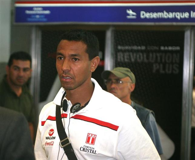 Peru's football player Nolberto Solano arrives at the airport in Luque, near Asuncion, October 12, 2008. REUTERS/Christian Adorno