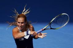 Dominika Cibulkova of Slovakia hits a return to Maria Sharapova of Russia during their women's singles match at the Australian Open 2014 tennis tournament in Melbourne January 20, 2014. REUTERS/David Gray