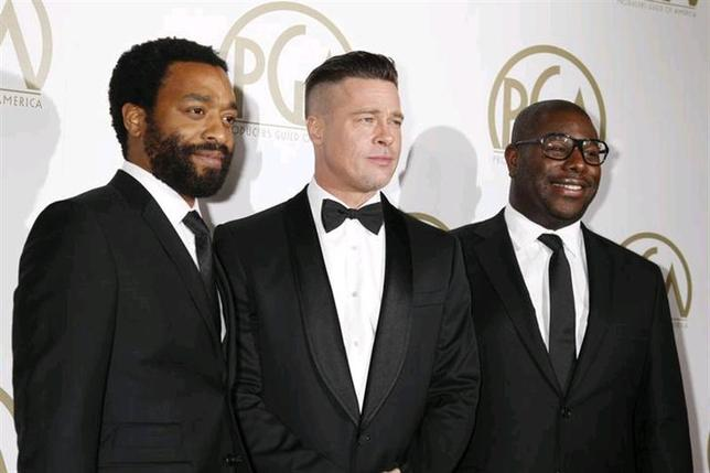 Brad Pitt (C) and Steve McQueen, producers of the film ''12 Years A Slave'', along with cast member Chiwetel Ejiofor (L), arrive at the 25th Annual Producers Guild of America Awards in Beverly Hills, California January 19, 2014. REUTERS/Fred Prouser