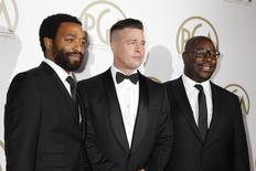 "Brad Pitt (C) and Steve McQueen, producers of the film ""12 Years A Slave"", along with cast member Chiwetel Ejiofor (L), arrive at the 25th Annual Producers Guild of America Awards in Beverly Hills, California January 19, 2014. REUTERS/Fred Prouser"