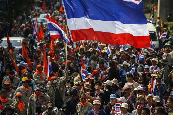 Anti-government protesters gather outside the Government Savings Bank building during a rally in Bangkok January 20, 2014. REUTERS-Athit Perawongmetha