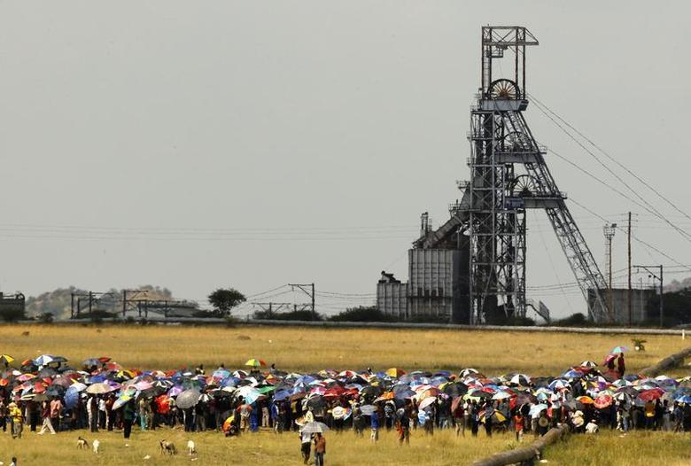 Striking miners gather for a meeting outside the Impala Platinum mine in Rustenburg, 120 km (74.6 miles) northwest of Johannesburg February 21, 2012. REUTERS/Sipiwe Sibeko