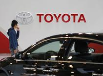 A man walks past Toyota Motor's logo at the company's showroom in Tokyo November 6, 2013. REUTERS/Toru Hanai