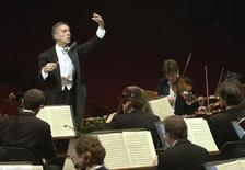 Italian conductor Claudio Abbado conducts the Berliner Philharmonic Orchestra during rehearsal in Rome's Santa Cecilia Auditorium February 8, 2001.