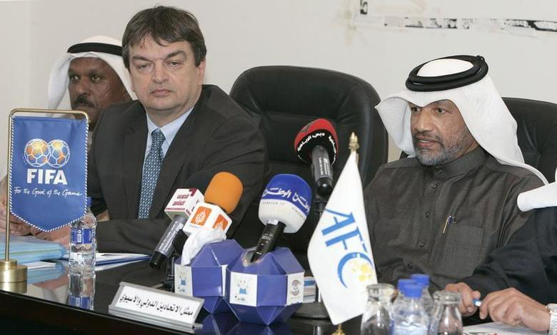 Asian Football Confederation's president, Mohammed Bin Hammam (R), and Jerome Champagne (2nd R), FIFA's director for international relations, attend a meeting with Kuwaiti Clubs in Kuwait February 9, 2008. REUTERS/Tariq AlAli