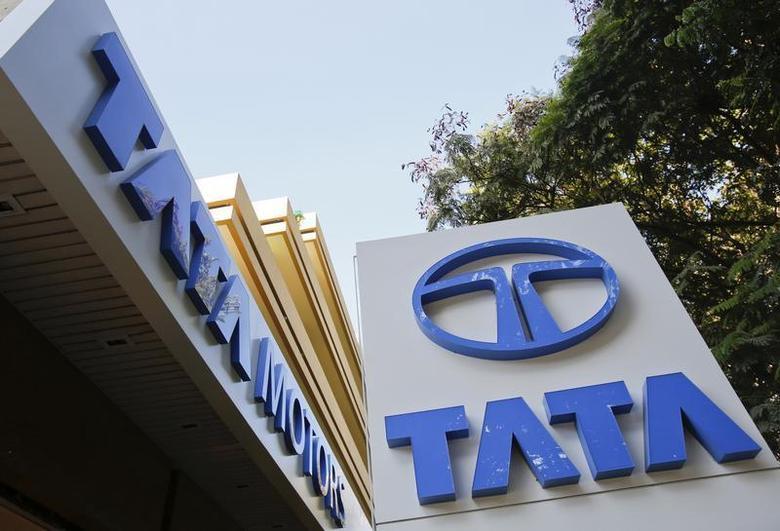 Tata Motors logos are pictured outside their flagship showroom in Mumbai May 28, 2013. REUTERS/Vivek Prakash/Files