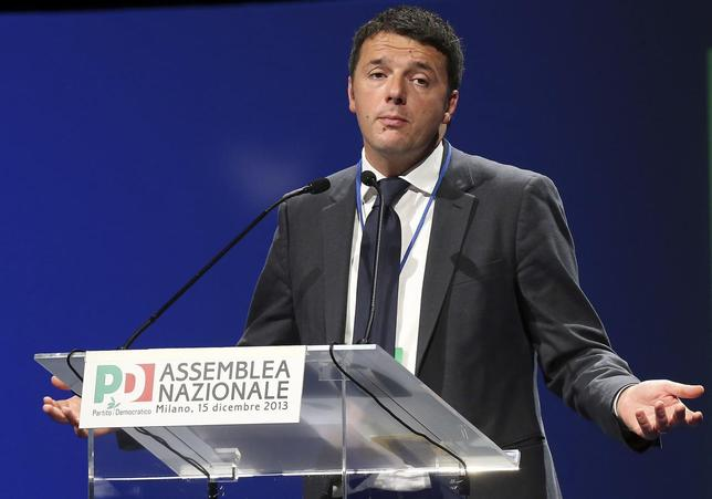 New elected centre-left Democratic Party (PD) leader Matteo Renzi gestures during his first national meeting in Milan, December 15, 2013. REUTERS/Stringer