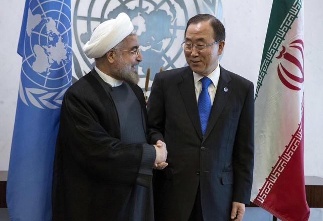 United Nations Secretary-General Ban Ki-moon (R) greets Iran's President Hassan Rohani during the U.N. General Assembly at U.N. Headquarters in New York in this file photo taken September 26, 2013. REUTERS/Eric Thayer/Files