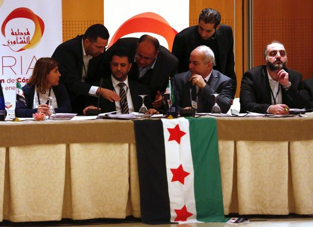 Syrian former parliamentary member Mohammad Barmo (3rd L) and members of Syrian opposition groups attend a consultative meeting in Cordoba, southern Spain January 10, 2014. REUTERS/Marcelo del Pozo