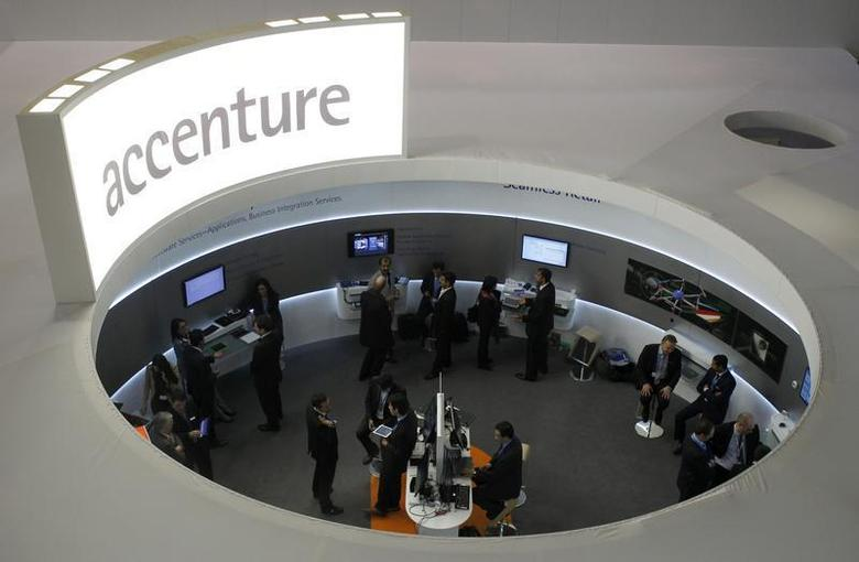 Visitors look at devices at Accenture stand at the Mobile World Congress in Barcelona, February 26, 2013. REUTERS/Albert Gea/Files