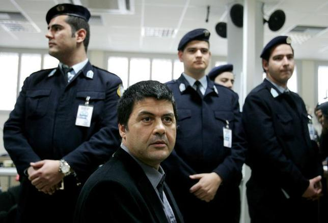 Greek member of November 17 urban guerrilla group Christodoulos Xiros (front) sits inside a court room in Korydallos prison, a few kilometres west of Athens December 2, 2005. REUTERS/Yiorgos Karahalis