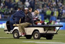 Jan 19, 2014; Seattle, WA, USA; San Francisco 49ers inside linebacker NaVorro Bowman (53) is carted off the field after an injury against the Seattle Seahawks during the second half of the 2013 NFC Championship football game at CenturyLink Field. Mandatory Credit: Kirby Lee-USA TODAY Sports