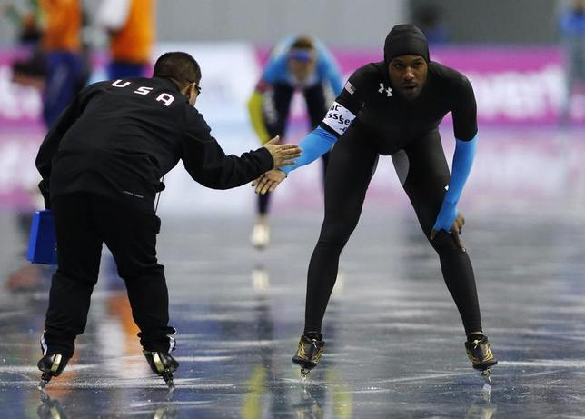 Shani Davis (R) of the U.S. reacts after the men's 1,000m event at the ISU World Sprint Speed Skating Championships in Nagano, central Japan, January 19, 2014. REUTERS/Issei Kato