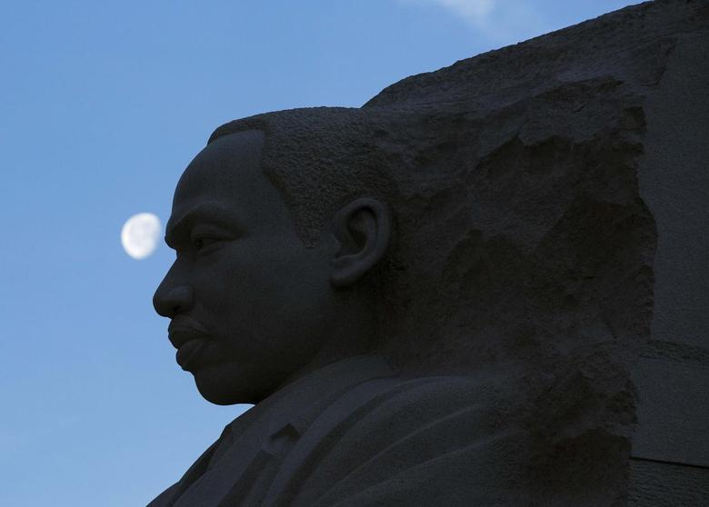 The moon sets over the Martin Luther King, Jr. Memorial during celebrations of the birthday of the civil rights leader in Washington January 20, 2014. REUTERS/Joshua Roberts