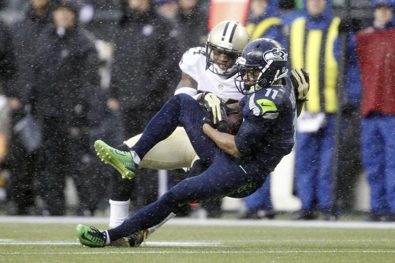 Jan 11, 2014; Seattle, WA, USA; Seattle Seahawks wide receiver Percy Harvin (11) catches a pass against New Orleans Saints cornerback Corey White (24) during the first half of the 2013 NFC divisional playoff football game at CenturyLink Field. Mandatory Credit: Joe Nicholson-USA TODAY Sports - RTX179XQ