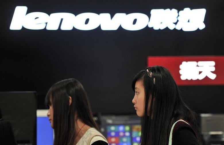 People walk past a Lenovo shop in Hefei, Anhui province, October 18, 2013. REUTERS/Stringer