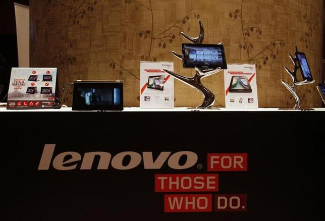 Lenovo tablets and mobile phones are displayed during a news conference on the company's annual results in Hong Kong May 23, 2013. REUTERS/Bobby Yip