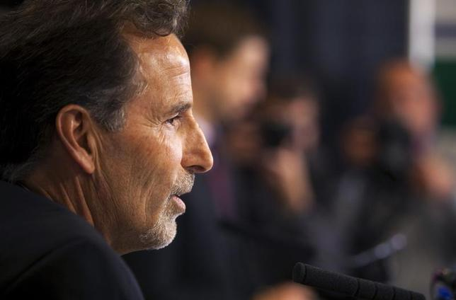 Vancouver Canucks new head coach John Tortorella talks to the media after he was introduced by Canucks General Manager Mike Gillis during a news conference in Vancouver, British Columbia June 25, 2013. REUTERS/Ben Nelms