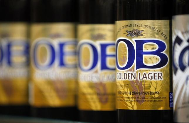 Bottled beers produced by South Korea's Oriental Brewery Co are displayed at the liquor section of a market in Seoul January 20, 2014. REUTERS/Kim Hong-Ji