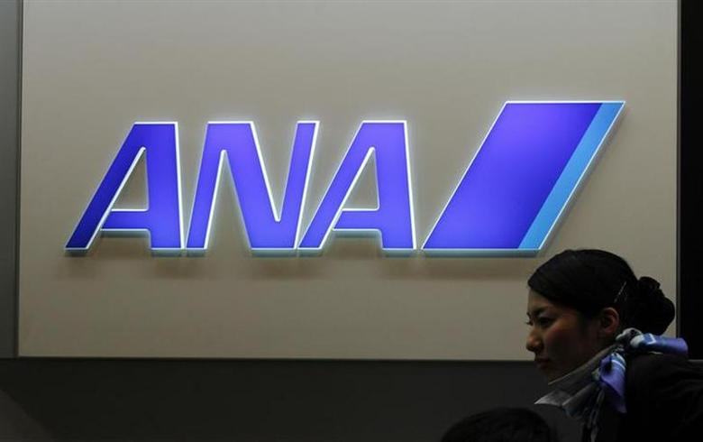 An employee walks past a All Nippon Airways (ANA) logo at New Tokyo international airport in Narita, east of Tokyo January 11, 2013. REUTERS/Shohei Miyano