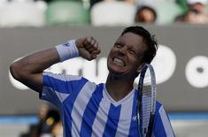 Tomas Berdych of the Czech Republic celebrates defeating David Ferrer of Spain in their men's singles quarter-final tennis match at the Australian Open 2014 tennis tournament in Melbourne January 21, 2014. REUTERS/Bobby Yip
