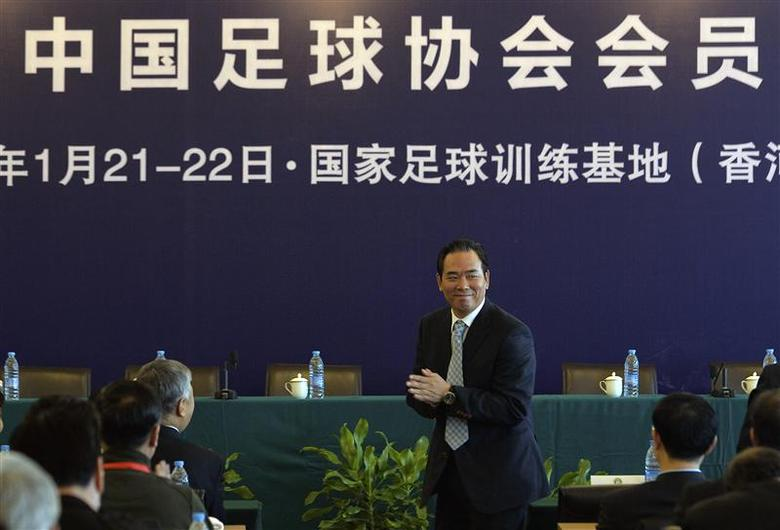 Cai Zhenhua, newly elected president of the Chinese Football Association (CFA), claps as he attends a meeting at National Football Training Base in Xianghe, Hebei province January 21, 2014. REUTERS/China Daily