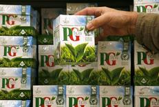 A shopper picks up a box of PG Tips tea bags at a Sainsbury's supermarket in London February 6, 2008. REUTERS/Luke MacGregor