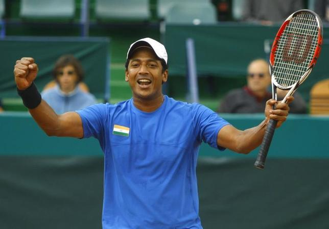 India's Mahesh Bhupathi celebrates after he and his teammate Leander Paes (unseen) won the Davis Cup doubles tennis match against Romania's Adrian Cruciat and Horia Tecau in Bucharest September 20, 2008. REUTERS/Bogdan Cristel