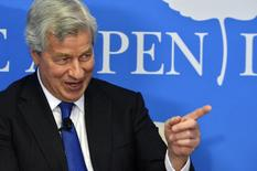 "JPMorgan Chase Chairman and CEO Jamie Dimon speaks during a discussion on ""Closing the Workforce Skills Gap"", at the Aspen Institute in Washington December 12, 2013 file photo. REUTERS/Mike Theiler"