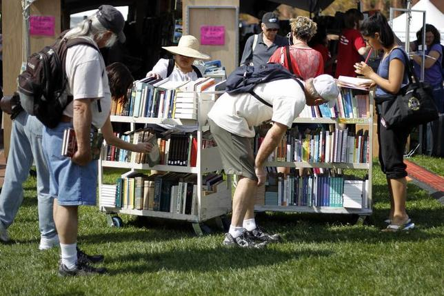 Festival goers shop for books at the ''$5.00 or less BOOKSTORE'' booth at the Los Angeles Times Festival of Books on the campus of the University of Southern California in Los Angeles April 21, 2012 file photo. REUTERS/Danny Moloshok