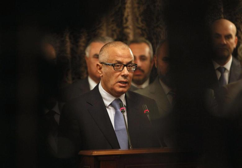 Libya's Prime Minister Ali Zeidan speaks during a news conference at the headquarters of the prime minister's office in Tripoli October 11, 2013. REUTERS/Ismail Zitouny