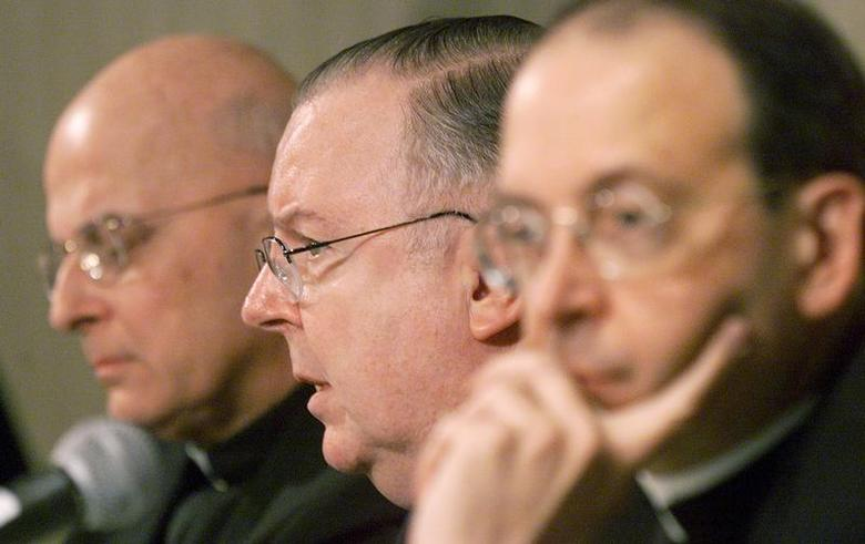 Cardinal Francis George of the Chicago Archdiocese (L), Bishop Thomas Doran of Rockford, IL. (C) and Bishop William Lori of Bridgeport, Ct. (R) address the media on norms for dealing with Allegations of Sexual Abuse in the Catholic Church during a press conference at the U.S. Conference of Catholic Bishops (U.S.C.C.B.) annual meeting in Washington November 13, 2002. REUTERS/Brendan McDermid
