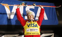 Jan 11, 2014; Park City, UT, USA; First place finisher Hannah Kearney of the United States takes the podium after women's FIS World Cup moguls event at Deer Valley Resort. Mandatory Credit: Jim Urquhart-USA TODAY Sports