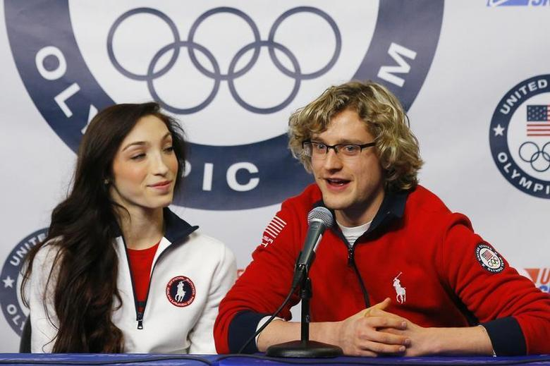 Ice dancing pair Meryl Davis (L) and Charlie White are introduced as part of the United States' team for the upcoming Sochi Winter Olympics, during a news conference at the U.S. Figure Skating Championships in Boston, Massachusetts January 12, 2014. REUTERS/Brian Snyder