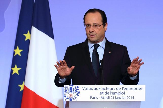 French President Francois Hollande delivers a speech at a New Year ceremony for employment sector representatives at the Elysee Palace in Paris, January 21, 2014. REUTER/Philippe Wojazer