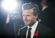 "Former England soccer captain David Beckham attends the world premier of the film ""The Class of 92"" in London December 1, 2013. REUTERS/Neil Hall"