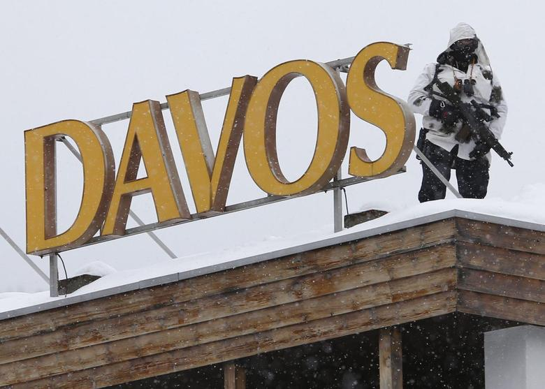 A Swiss special policeman patrols on a roof before the start of the annual meeting of the World Economic Forum (WEF) 2014 in Davos January 21, 2014. REUTERS/Ruben Sprich