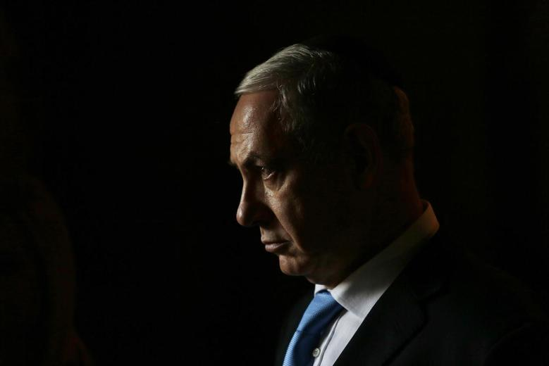 Israel's Prime Minister Benjamin Netanyahu leaves after attending a ceremony with Canada's Prime Minister Stephen Harper in the Hall of Remembrance at the Yad Vashem Holocaust memorial in Jerusalem January 21, 2014. REUTERS/Baz Ratner