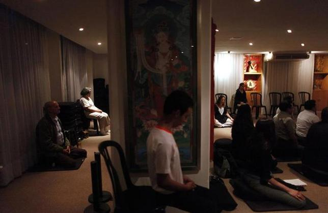 Mexican students of the Tibetan Buddhist culture meditate inside Tibet house in Mexico City, October 7, 2013. REUTERS/Edgard Garrido