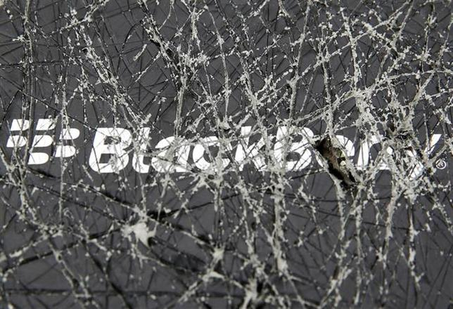 A Blackberry logo is seen through a cracked box in this photo illustration taken in the central Bosnian town of Zenica, September 24, 2013. REUTERS/Dado Ruvic