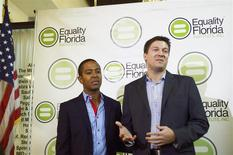 Plaintiffs Jeff Delmay (L) and Todd Delmay speak during a news conference at the LGBT Visitors Center in Miami Beach, Florida, January 21, 2014. REUTERS/Zachary Fagenson