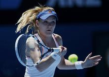 Agnieszka Radwanska of Poland hits a return to Victoria Azarenka of Belarus during their women's singles quarter-final tennis match at the Australian Open 2014 tennis tournament in Melbourne January 22, 2014. REUTERS/Bobby Yip