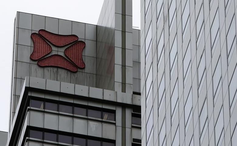 A DBS logo is seen on a building at its headquarters in Singapore April 2, 2012. REUTERS/Tim Chong