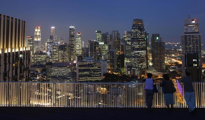 People look at the skyline of the central business district from the Skybridge of The Pinnacles at Duxton public housing estate in Singapore in this April 25, 2013 file photo. REUTERS/Edgar Su/Files