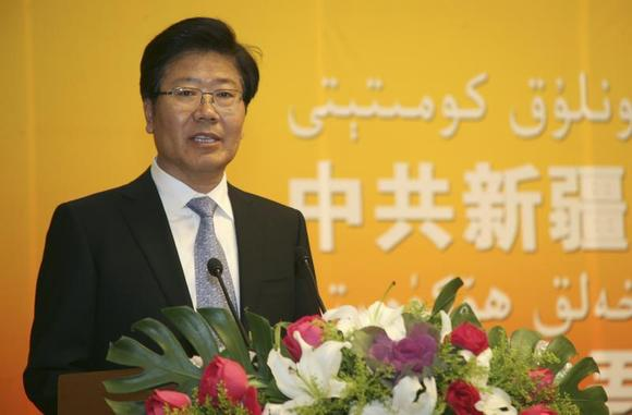 Secretary of the Communist Party of China (CPC) Committee of the Xinjiang Uyghur Autonomous Region Zhang Chunxian delivers a speech during a tea forum celebrating the Corban Festival in Urumqi, Xinjiang Uyghur Autonomous Region, November 5, 2011. REUTERS/China Daily