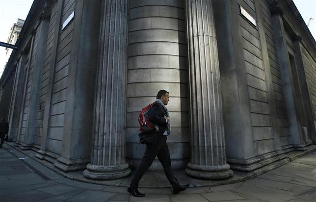 A man passes the Bank of England in the City of London January 16, 2014. REUTERS/Luke MacGregor