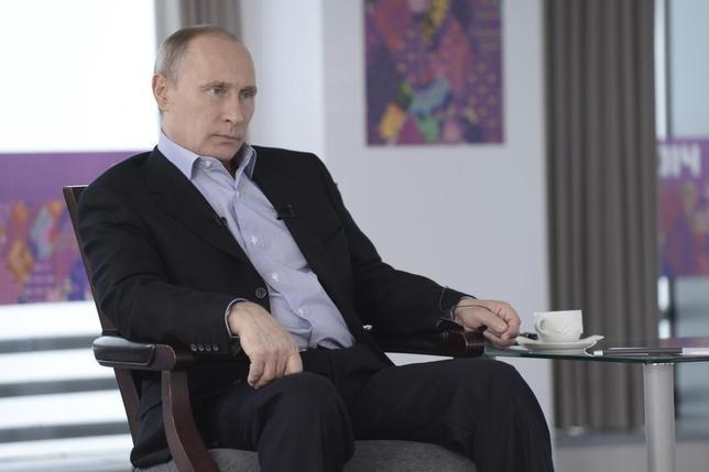 Russian President Vladimir Putin listens to a journalist's question during a televised news conference in Sochi January 19, 2014. REUTERS/Alexei Nikolsky/RIA Novosti/Kremlin