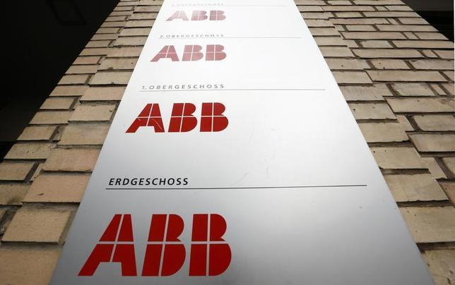 Logos of Swiss industrial group ABB are seen at an office building in Zurich July 25, 2013. REUTERS/Arnd Wiegmann