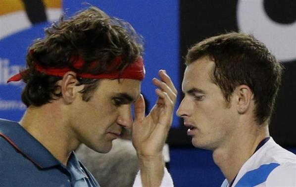 Roger Federer of Switzerland (L) walks past Andy Murray of Britain during their men's singles quarter-final tennis match at the Australian Open 2014 tennis tournament in Melbourne January 22, 2014. REUTERS/Jason Reed